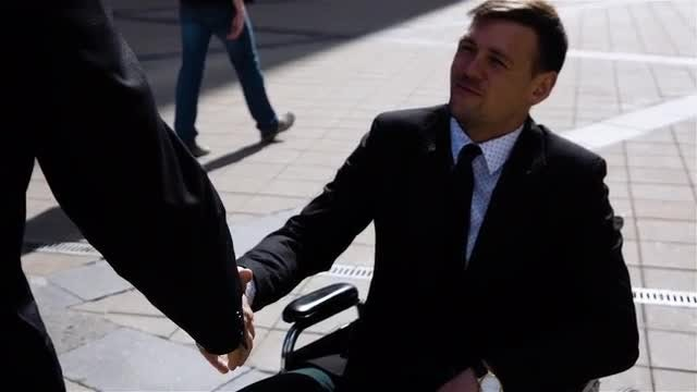 Handicapped Businessman Exchanging Handshake: Stock Video