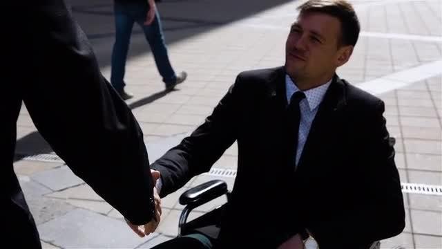 Handicapped Businessman Exchanging Handshake: Stock Video