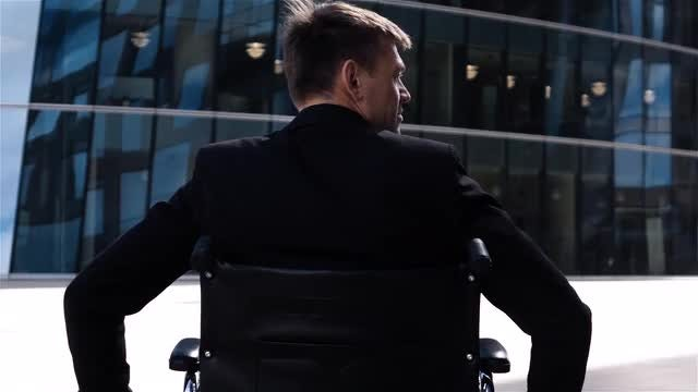 Disable Man Riding In Wheelchair: Stock Video