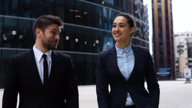 Business Colleagues Walking Outdoors: Stock Video