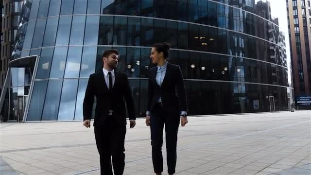 Business Colleagues Walking Outdoors : Stock Video
