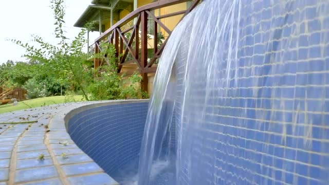 Slow-Motion Garden Waterfall: Stock Video