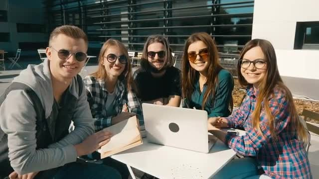 Group Of Students Seated Outdoors: Stock Video