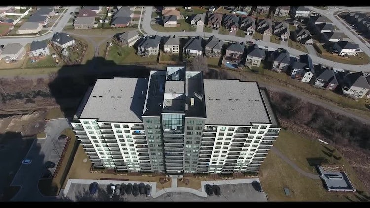 Flying Over Large Apartment Building: Stock Video