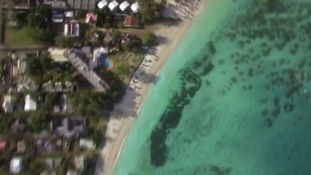 Mauritius Coast And Vacationing Family: Stock Video