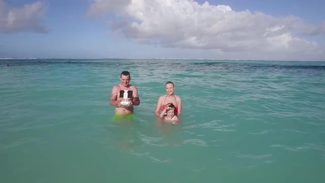 Family Bathing On The Beach : Stock Video