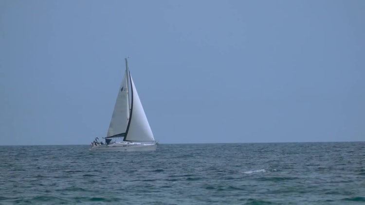 Yacht Sailing In Calm Ocean: Stock Video