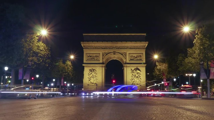 Nighttime Traffic Near Triumphal Arch: Stock Video