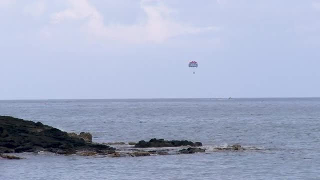 Parasailing Over The Ocean: Stock Video