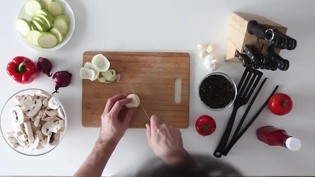Cutting Onions On Chopping Board : Stock Video