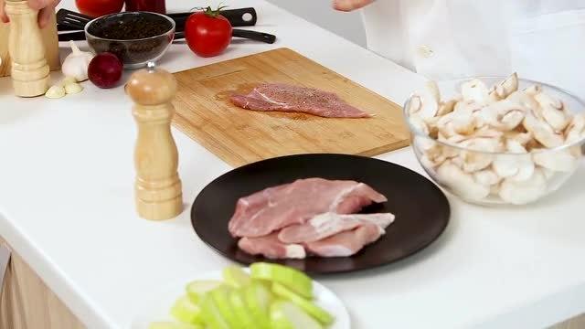 Chef Seasoning Raw Pork Meat: Stock Video