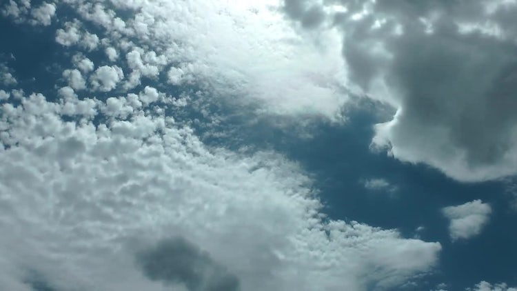 Shiny Rippled Clouds On Blue Sky: Stock Video