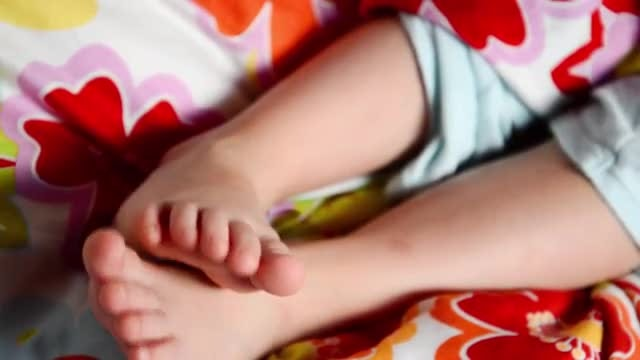 Close-up Of Little Kid's Feet: Stock Video