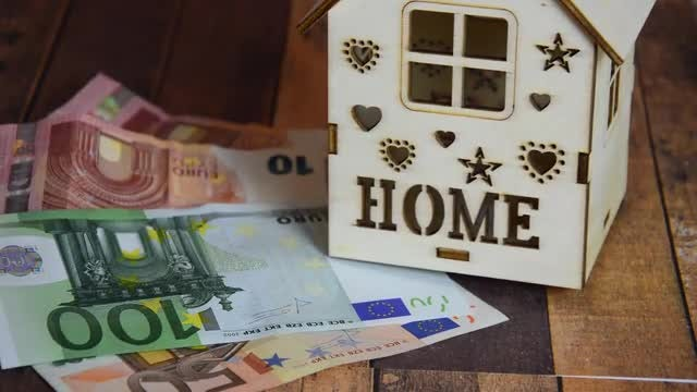 Wooden House Model And Banknotes : Stock Video