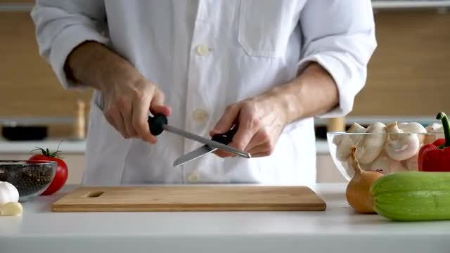 Cook Sharpens His Knives: Stock Video