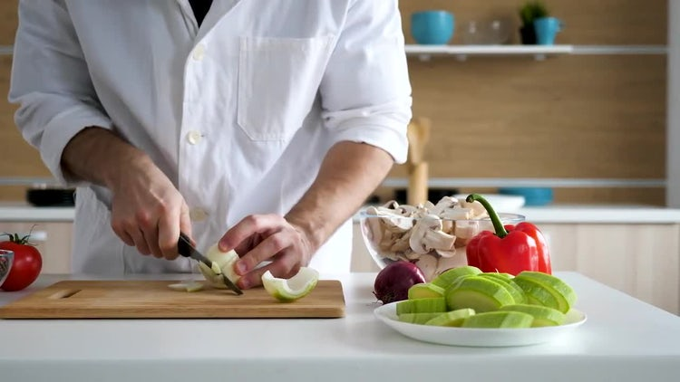 Chef Peeling And Cutting Onions: Stock Video