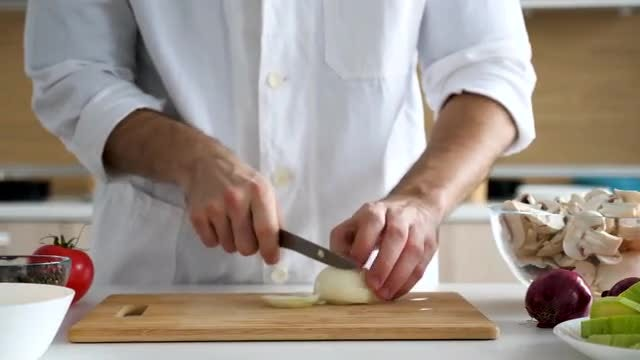 Chef Cutting White Onion: Stock Video