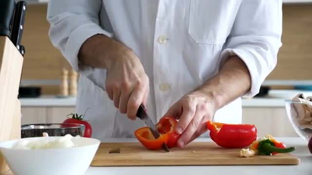Chef Cutting Sweet Red Pepper: Stock Video