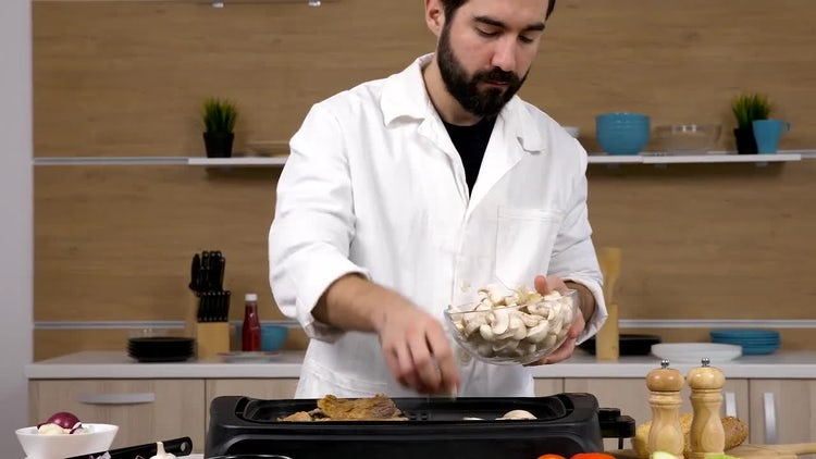 Cook Placing Mushrooms On Grill: Stock Video