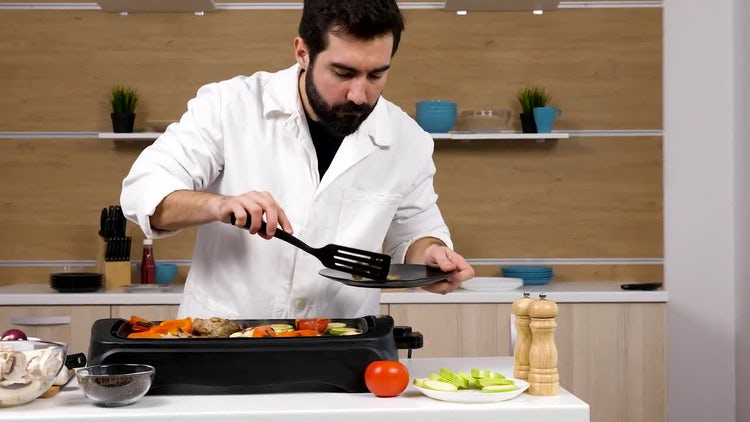 Male Chef Serving Grilled Vegetables: Stock Video