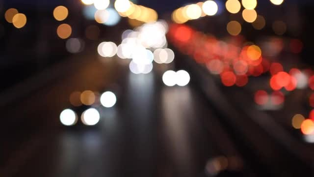 Bokeh Lights Of Night Traffic: Stock Video