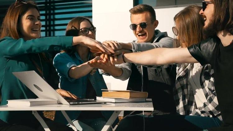 College Students Celebrate Successful Teamwork: Stock Video