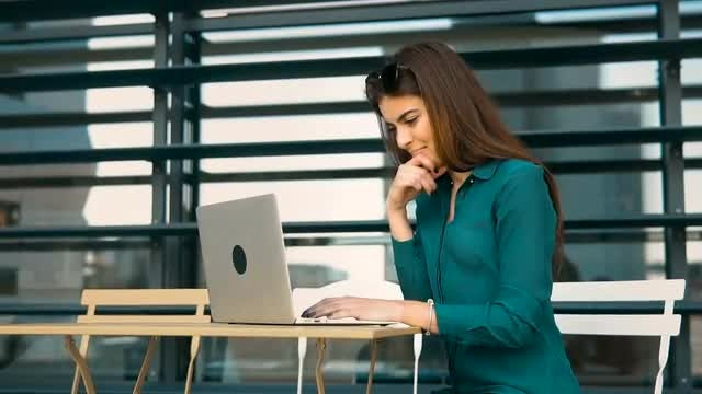 Female Student With Laptop Outdoors: Stock Video