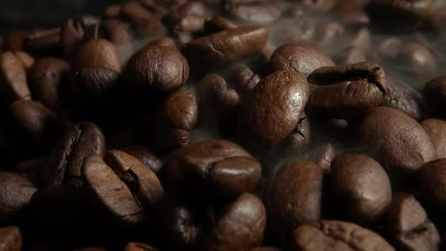 Steaming Hot Roast Coffee Beans: Stock Video