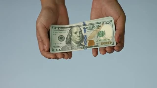 Hands Holding Hundred Dollar Bills: Stock Video