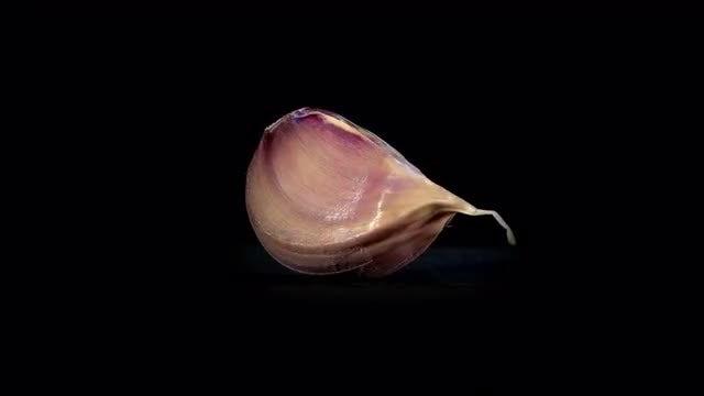 Purple Garlic Clove, Rotating Loop: Stock Video