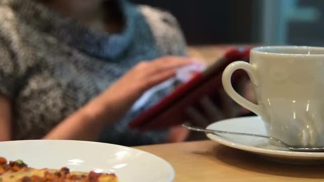 Surfing The Tablet During Lunch: Stock Video