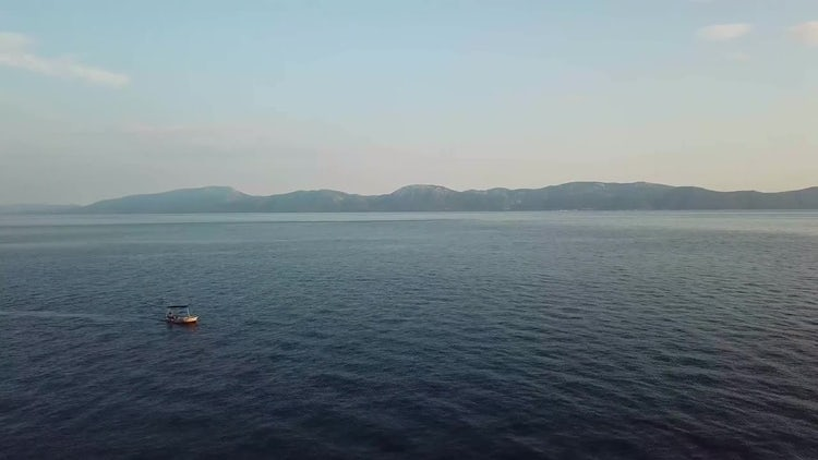 Aerial View Of A Boat Sailing In Clear Waters : Stock Video