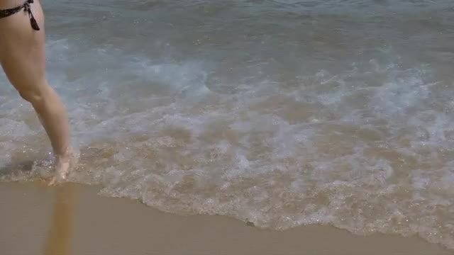 Woman Walking Out of The Sea : Stock Video