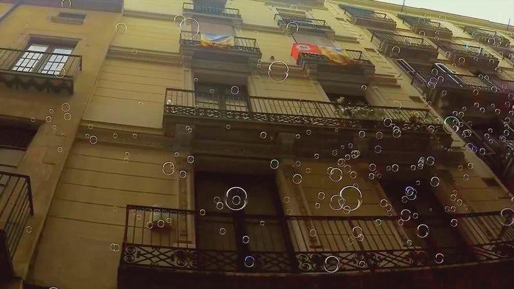 Soap Bubbles In A Narrow City Street: Stock Video