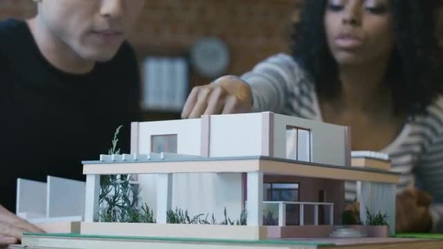 Young Architects Creating House Model: Stock Video