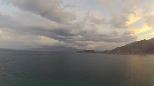 Timelapse With Clouds, Water, and Mountains: Stock Video
