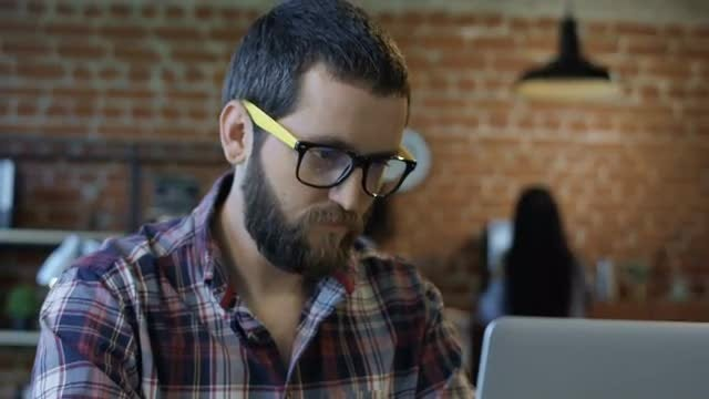 Focused Bearded Man Using Computer: Stock Video