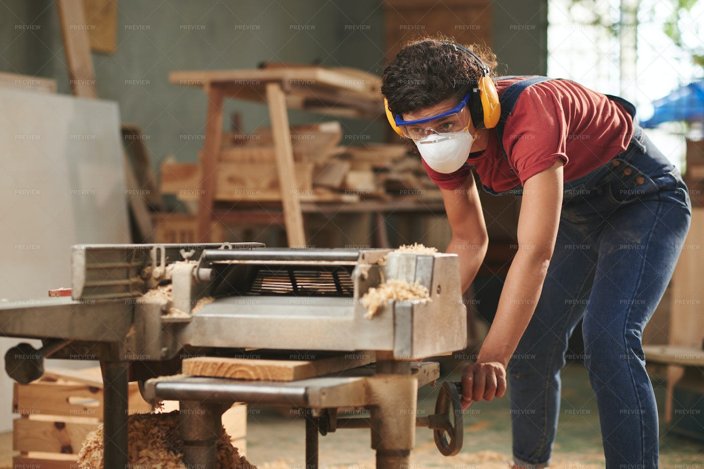 Using A Woodworking Machine: Stock Photos