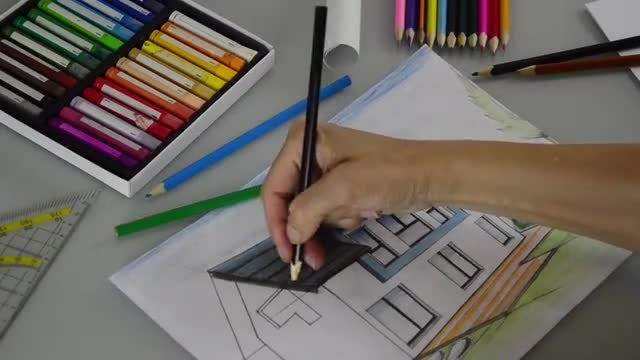 Architect Coloring A House Drawing: Stock Video