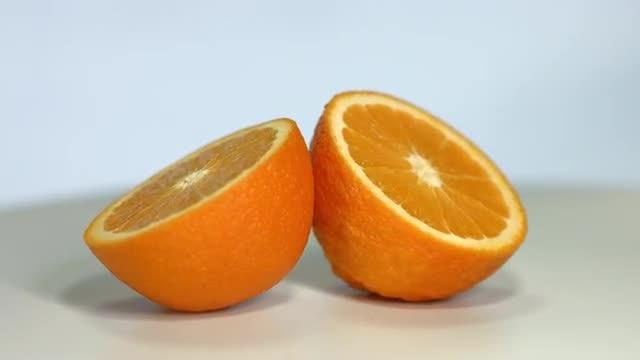 Orange sliced rotating: Stock Video