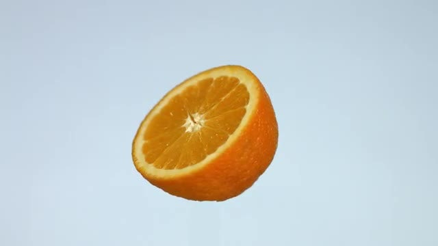 Piece Of Orange Rotating: Stock Video