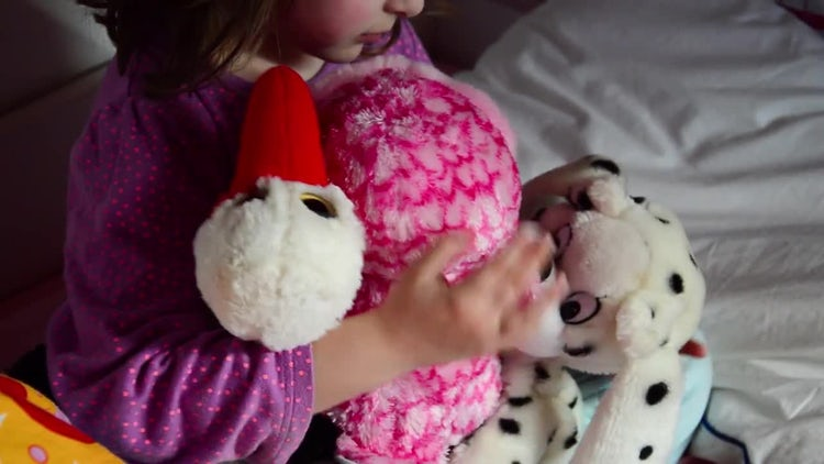 Little Girl Holding Bear Dolls: Stock Video