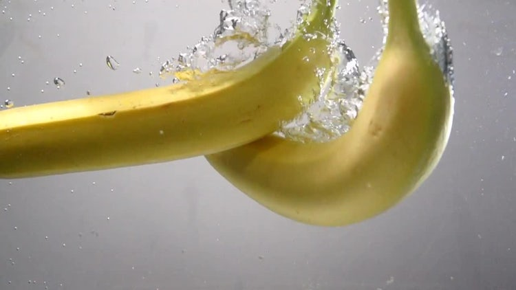 Bananas Dropping Into The Water: Stock Video