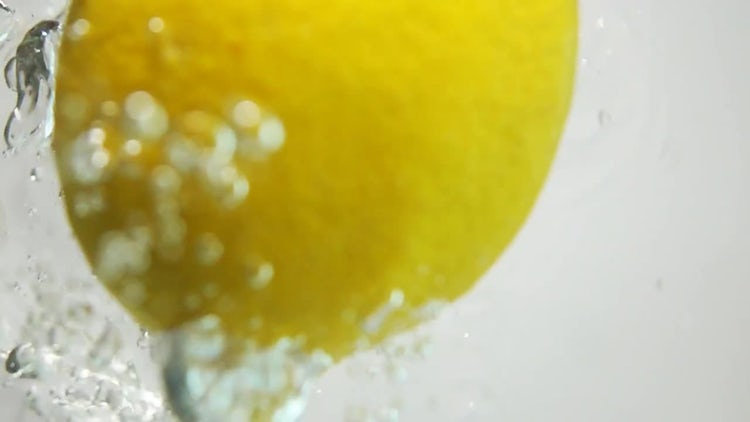 Lemon Plunging Into Water: Stock Video