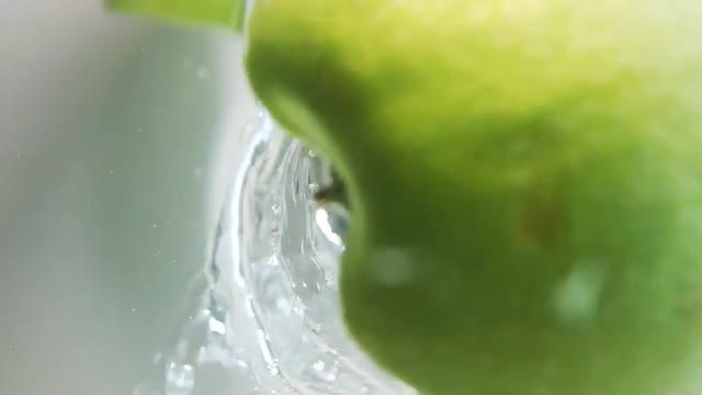 Apple Slices Fall Into Water: Stock Video