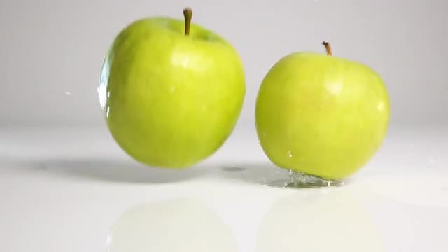 Apples Dropped On White Surface: Stock Video