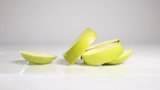 Sliced Apple Falls And Separates: Stock Video