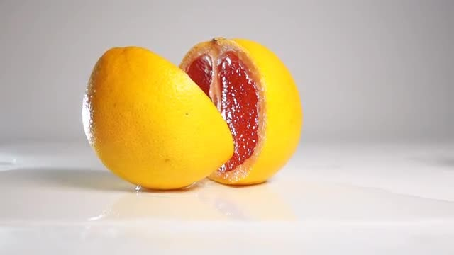 Grape Fruit Breaking Into Two : Stock Video