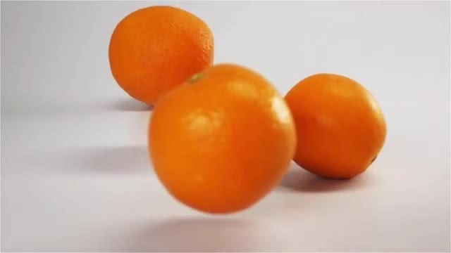 Oranges Falling On White Surface: Stock Video
