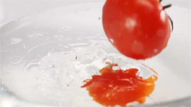 Red Tomatoes Splashing Into Water: Stock Video
